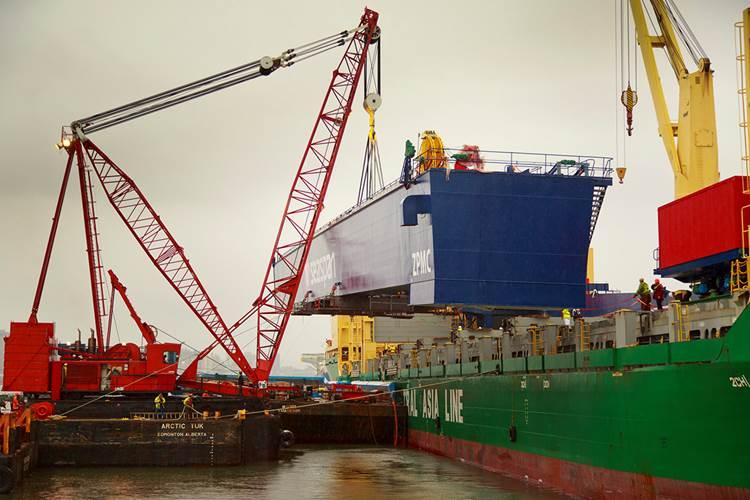 The main girder of Vancouver Shipyard's new 300-metric-tonne Gantry Crane offloading at Fraser Surrey Docks on Saturday, February 15, 2014