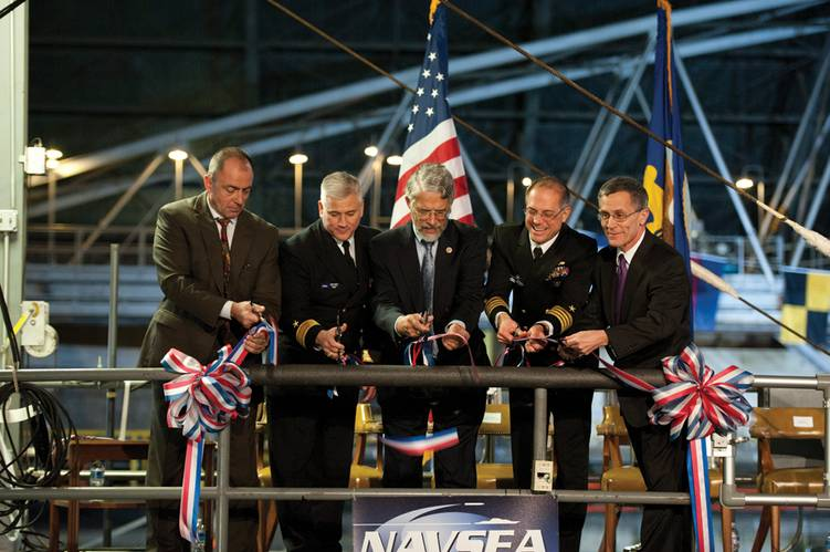Naval Surface Warfare Center, Carderock Division Naval Architecture & Engineering Department Head, Jon Etxegoien, right, Naval Surface Warfare Center Commander, Rear Adm. Lawrence Creevy, Dr. John Holdren, Assistant to the President for Science and Technology, Director of the White House Office of Science and Technology Policy, and Co-Chair of the President's Council of Advisors on Science and Technology, NSWC, Carderock, Commander Capt. Richard Blank, and NSWC, Carderock, Technical Director Dr.