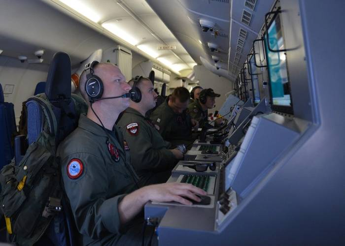 Crew members on board a P-8A Poseidon assigned to Patrol Squadron (VP) 16 man their workstations while assisting in search and rescue operations for Malaysia Airlines flight MH370. VP-16 is deployed in the U.S. 7th Fleet area of responsibility supporting security and stability in the Indo-Asia-Pacific. (U.S. Navy photo by Eric A. Pastor)