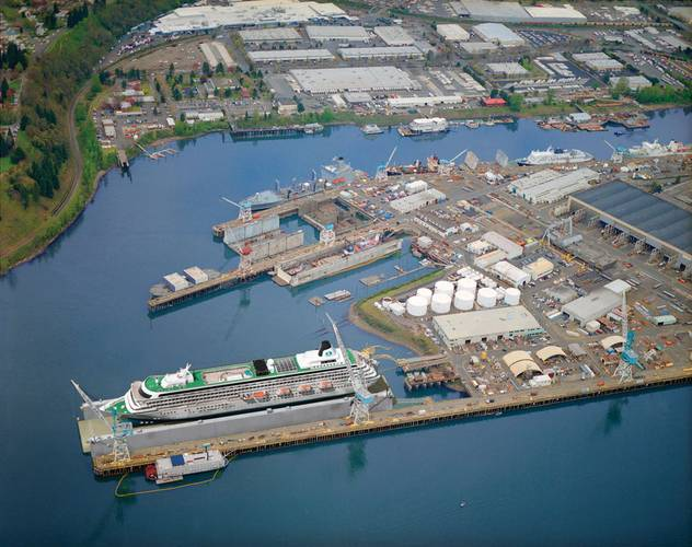 Image above: Vigor's 60-acre shipyard on Swan Island near Portland, Oregon with artist's rendering of soon-to-be-delivered largest floating dry dock in the United States.