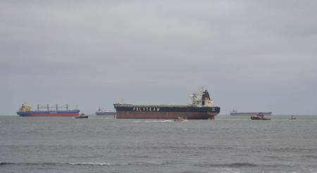 A bulk carrier ship was refloated Friday morning after running aground near Virginia Beach. (USCG photo)