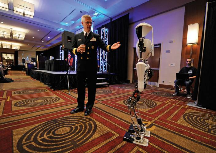 Rear Adm. Matthew L. Klunder, Chief of Naval Research, introduces CHARLI-2 from Virginia Tech's Robotics & Mechanisms Laboratory during the Office of Naval Research (ONR) 2012 Science and Technology Partnership Conference. (U.S. Navy photo by John F. Williams)
