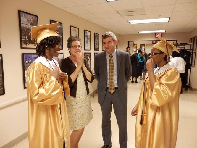 Mike and Nancy Petters congratulate An Achievable Dream Class of 2014 Valedictorian Taylor Braxton (left) and Salutatorian Briana Jones (right) for their achievements. (Photo courtesy of An Achievable Dream)