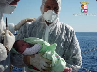 Italy's Operation Mare Nostrum rescued record numbers of migrants from the Mediterranean Sea between North Africa and Italy (Italian Navy photo)