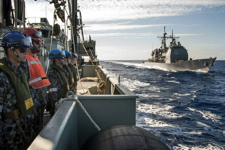 Members of HMAS Success's Ships Company turn and face outwards as the Ticonderoga Class Cruiser USS Port Royal makes her approach to conduct a RAS (Replenishment at Sea) off the coast of Hawaii (Photo: Brenton Freind)