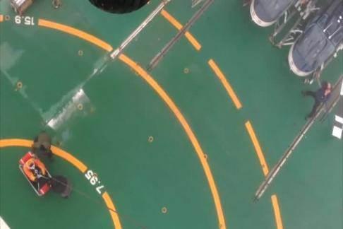 A Coast Guard Air Station Kodiak MH-60 Jayhawk helicopter crew medevacs an injured man from the South Korean research icebreaker Araon 250 miles north of Barrow, Alaska, Aug. 20, 2014. (USCG video)