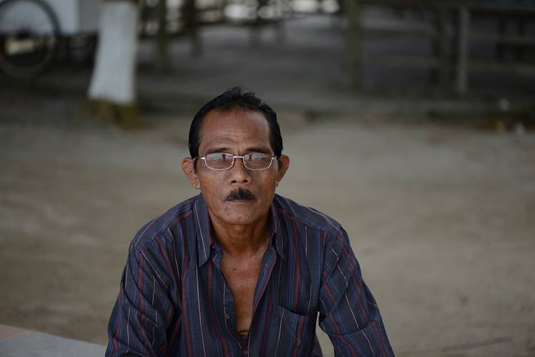"""Mr Abdul"", a senior pirate leader from the Karimun gang,  poses for the camera. The high number of reported petty attacks in South East Asia  belie the high potential for lethal violence in the region.  Photo: Karsten von Hoesslin"