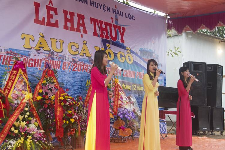 "Songs to honor the new boat. The banner says, ""Launching ceremony/ Wooden Fishing vessel/ In accordance with Decree 67/ NDCP by the Government/ 30 December 2015. (Haig-Brown photos courtesy of Cummins Marine)"