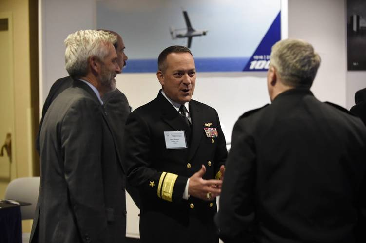 Rear Adm. Winter talks with exhibitors during the 28th annual Surface Navy Association (SNA) National Symposium. (U.S. Navy photo by John F. Williams)