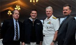 "From Left: John O'Malley, owner and publisher, Marine Technology Reporter; Rob Howard, VP Sales & Marketing; U.S. Navy CNO Admiral Gary Roughead; and Greg Trauthwein, Associate Publisher and Editor. The CNO was conferred ""Seamaster 2011"" at the OceanTech Expo in Newport, RI. (Photo: U.S. Navy)"