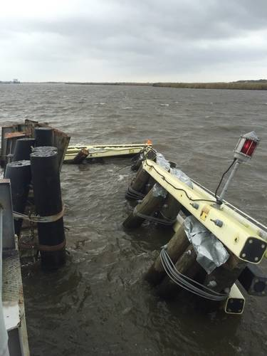 Near the end of a swung open Black Bayou Bridge, sits a damaged fender after it was hit by a boat when the boat lost steering March 7, 2016. The waterway was temporarily closed to highway and marine traffic, due to damage to the bridge. (U.S. Coast Guard photo by Jennifer Andrew)