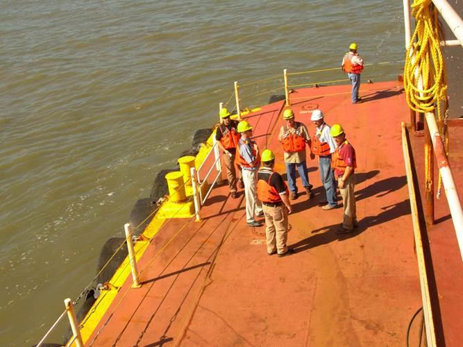 GLDD crew planning next task on the deck.